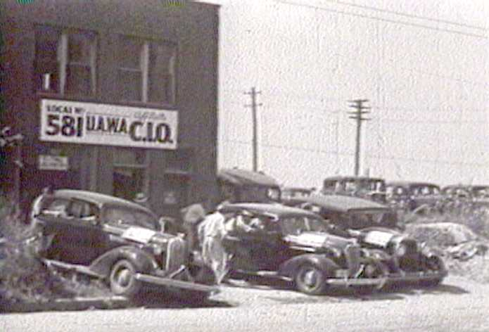 Auto workers jump into their cars as they activate the flying squads during the strike.