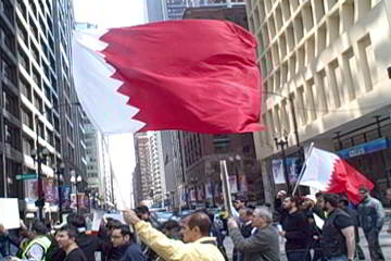 The flag of Bahrain as it crosses Dearborn St. in Chicago's Loop. Photo: Labor Beat.