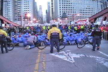 Nov. 17, 2011 protest blocks Chicago's Loop traffic on LaSalle St. Bridge. Labor Beat.
