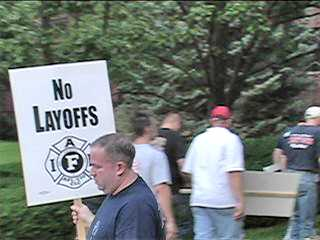 Evanston Firefighters union members protest City layoffs. Photo: Gary Brooks / Labor Beat.