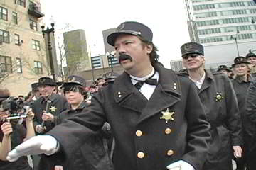 Cops march up Desplaines Street to break up Haymarket Square rally in 1886 reenactment. Photo: Labor Beat.